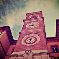 Piazza Tre Martiri's clock tower - la torre dell'Orologio