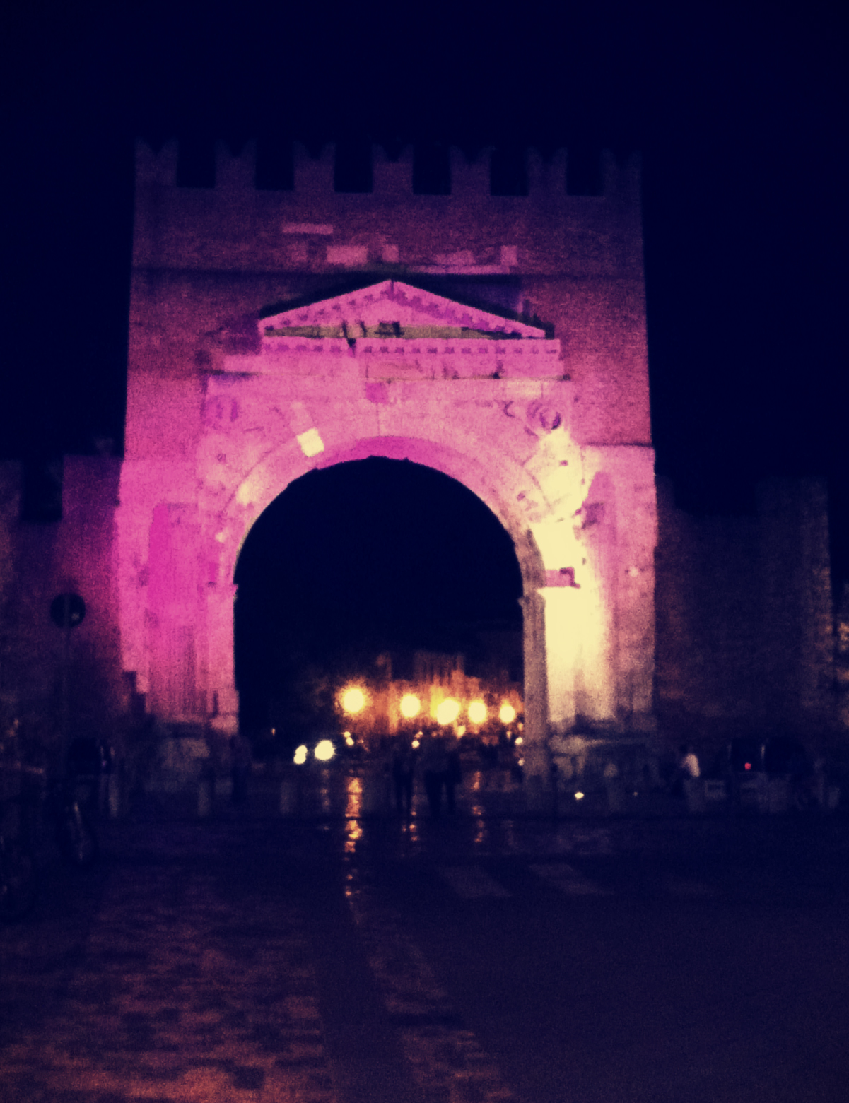 The Arco d'Augosto lit up in preparation for the Notte Rosa
