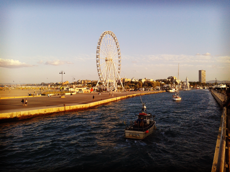rimini port canal with the panoramic wheel
