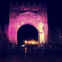 The Arco d'Agosto lit up in preparation for the Notte Rosa