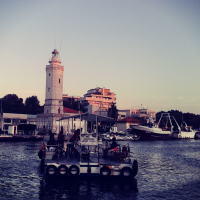 Rimini's lighthouse and ferry across the port canal